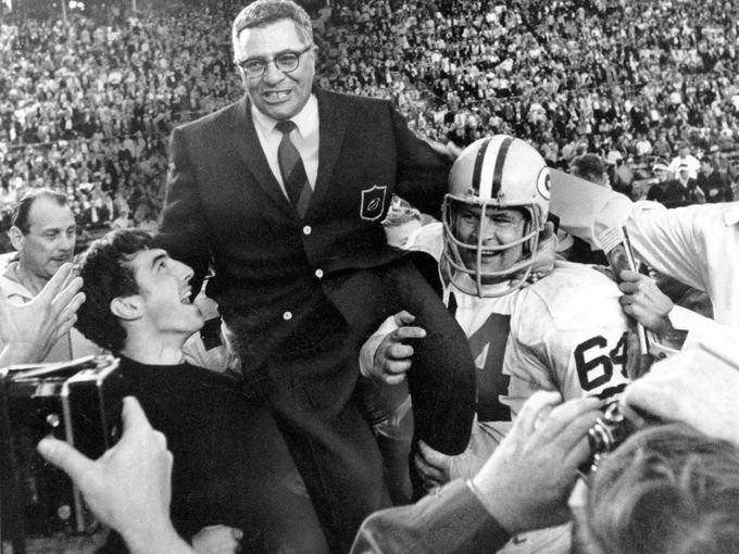 vince lombardi carried off the field