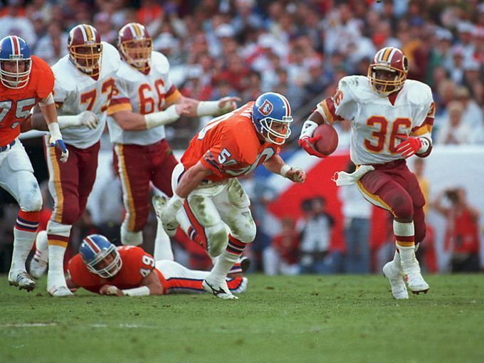 timmy smith runs from the broncos