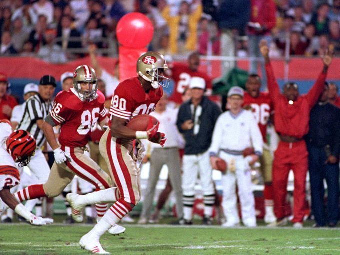 23 jerry rice catches a ball in a rematch of 49ers bengals