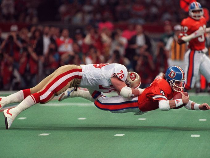 john elway goes for extra yards against the 49ers