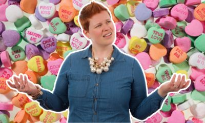 confused woman over candy hearts