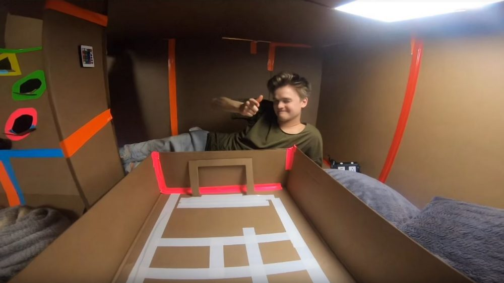 guys playing arcade games in box fort