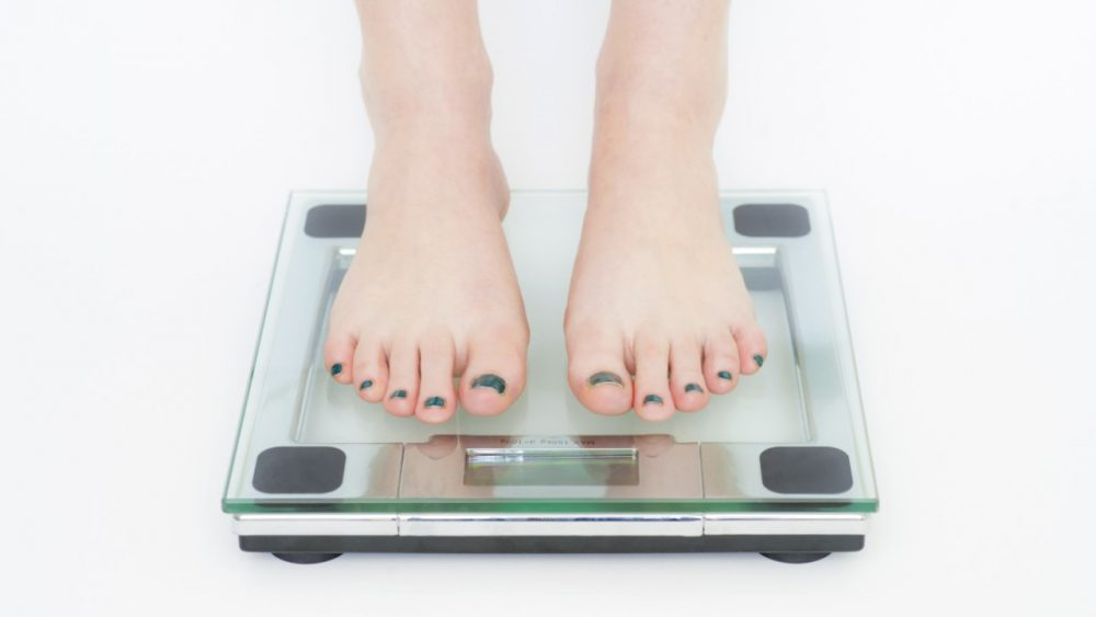 feet weighing on scale