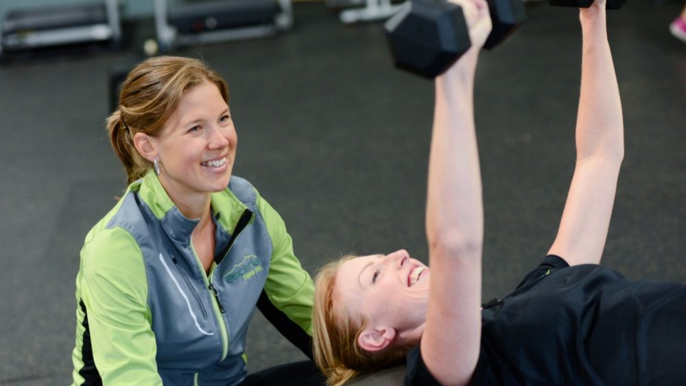 two women smiling and exercising