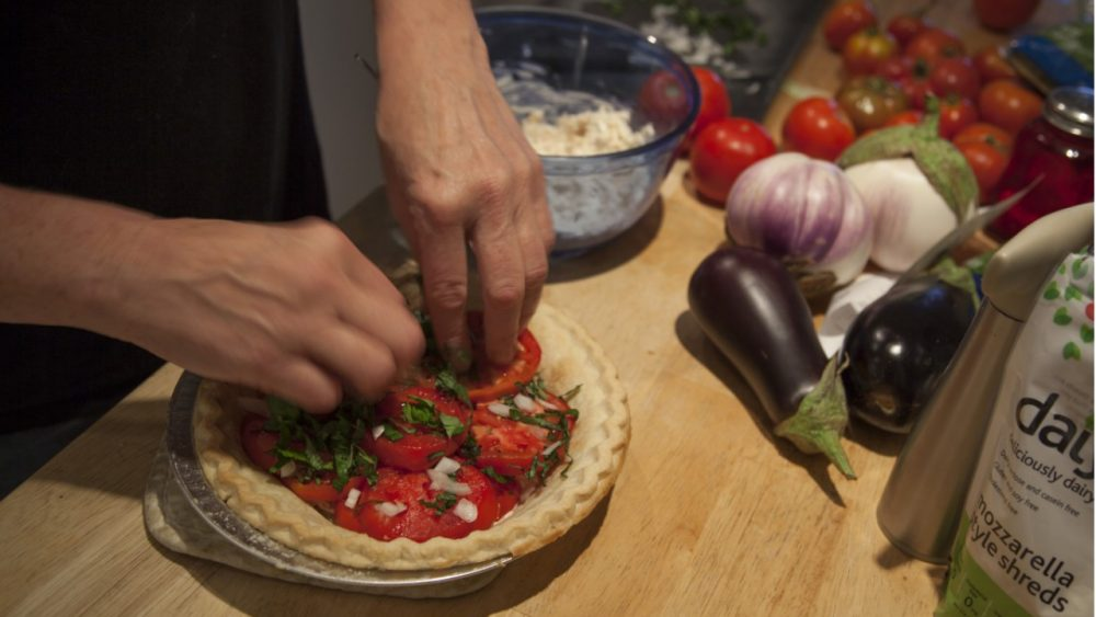 person making recipe with tomatoes