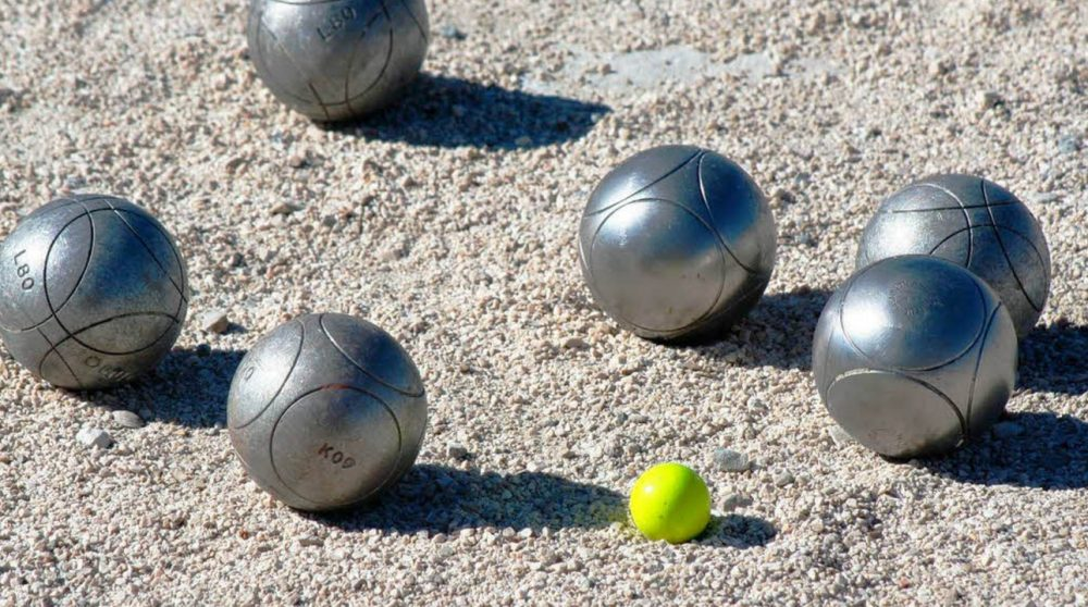 silver bocce balls and yellow tiny ball