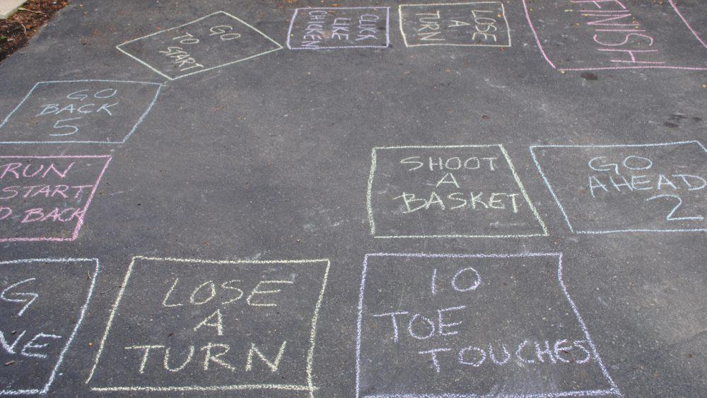 board game drawn in chalk on driveway