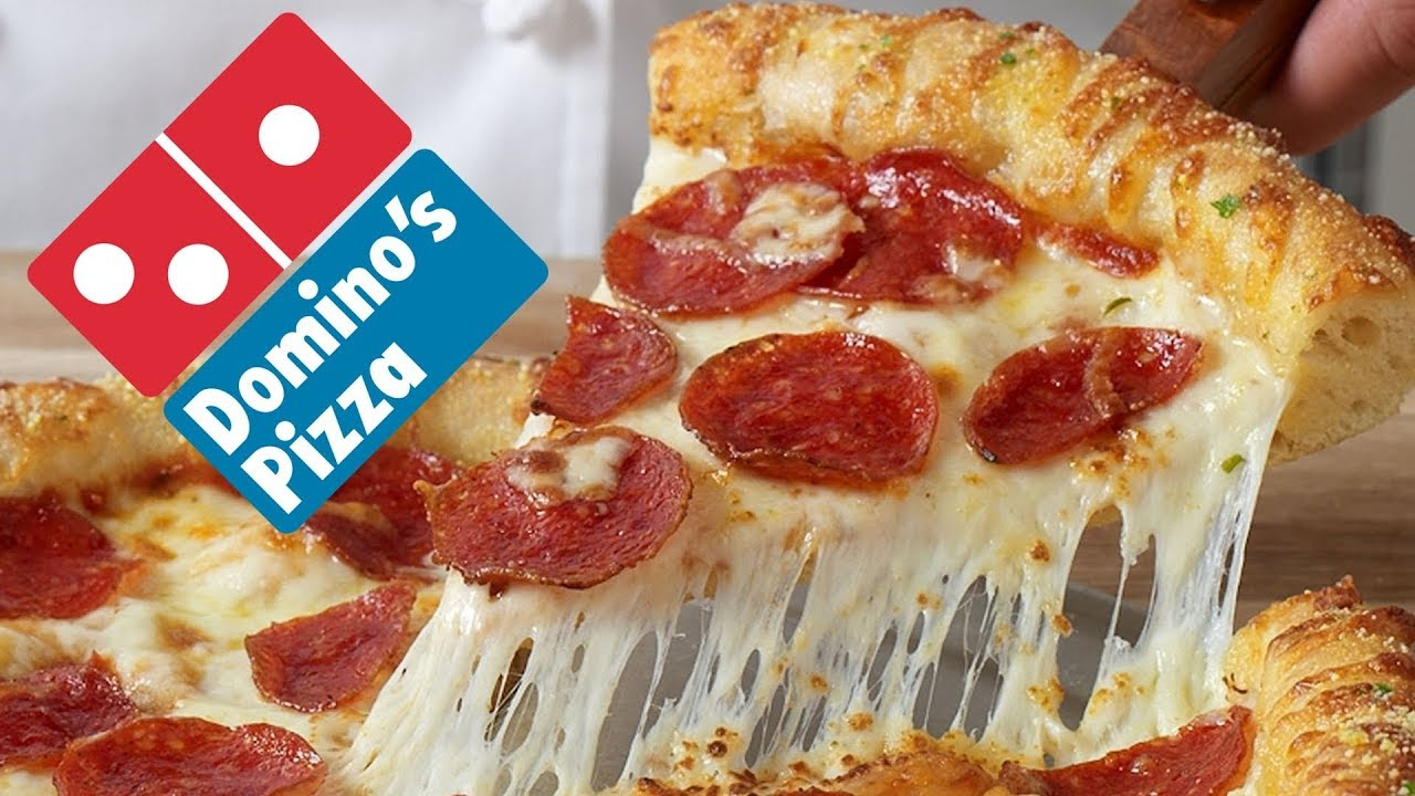 The Top Untold Truths of Domino's Pizza