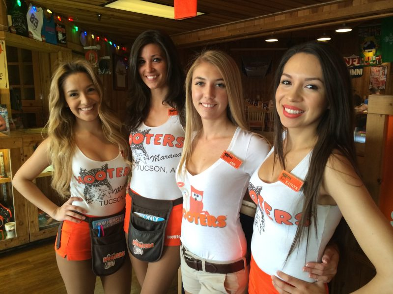Hooters girls posing for a restaurant photo