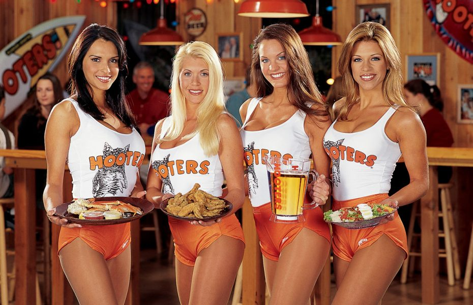 Hooters girls ad holding beer and chicken wings