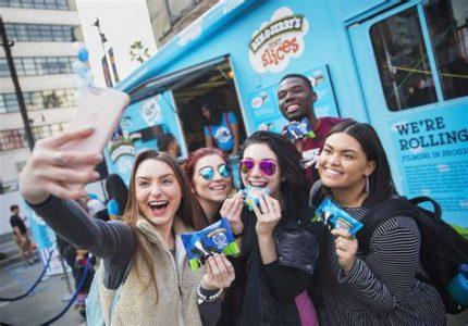 Taking group selfie in front of Ben & Jerry's mobile scooping station