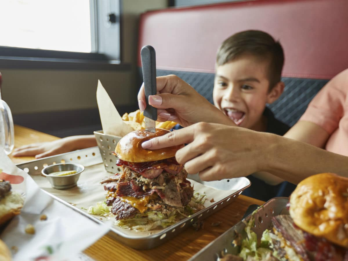 kid looking at Chili's burger