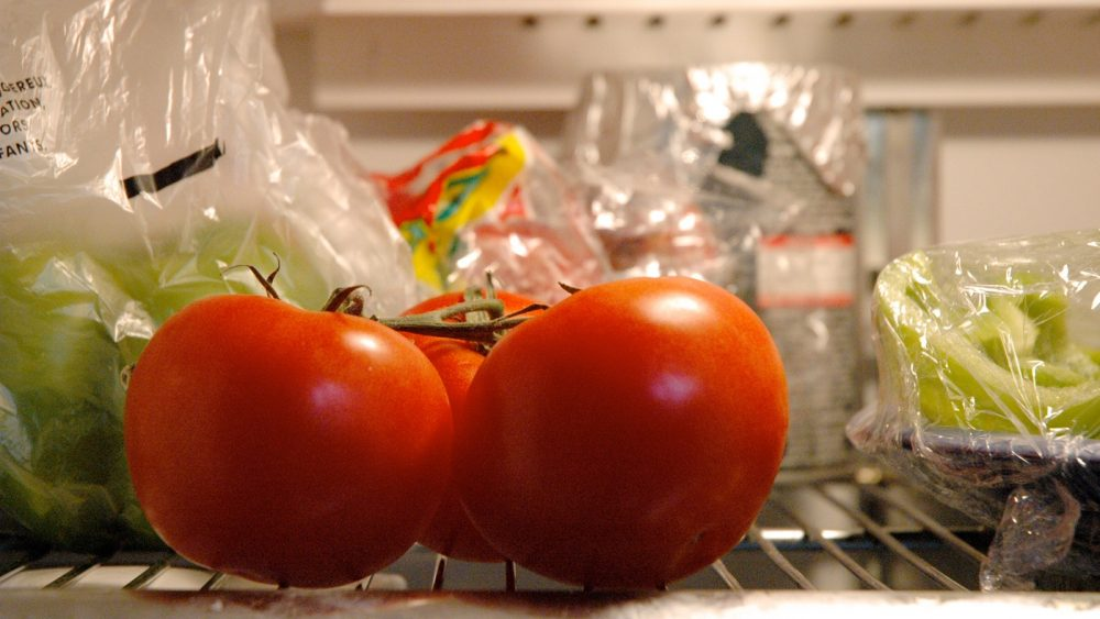 tomatoes being stored in the fridge