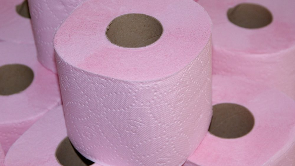 stacks of pink toilet paper rolls