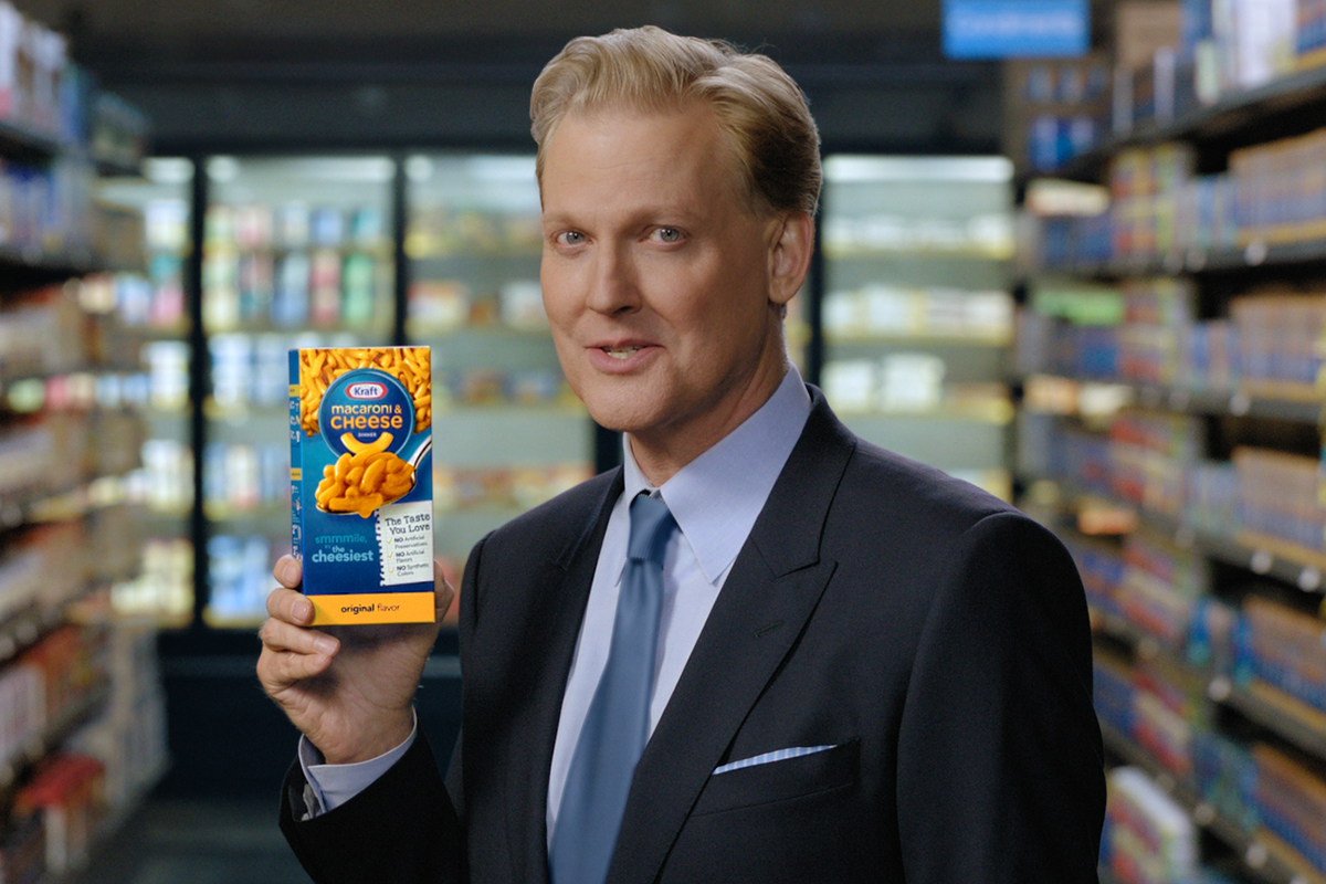 Man holding box of Kraft Dinner