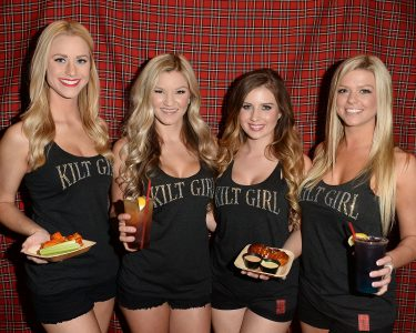 Tilted Kilt servers in black uniform