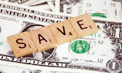 "letters ""save"" on top of money"