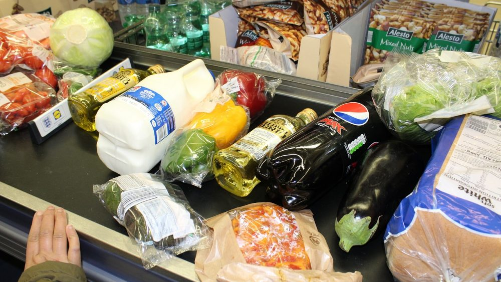 food items on grocery checkout counter