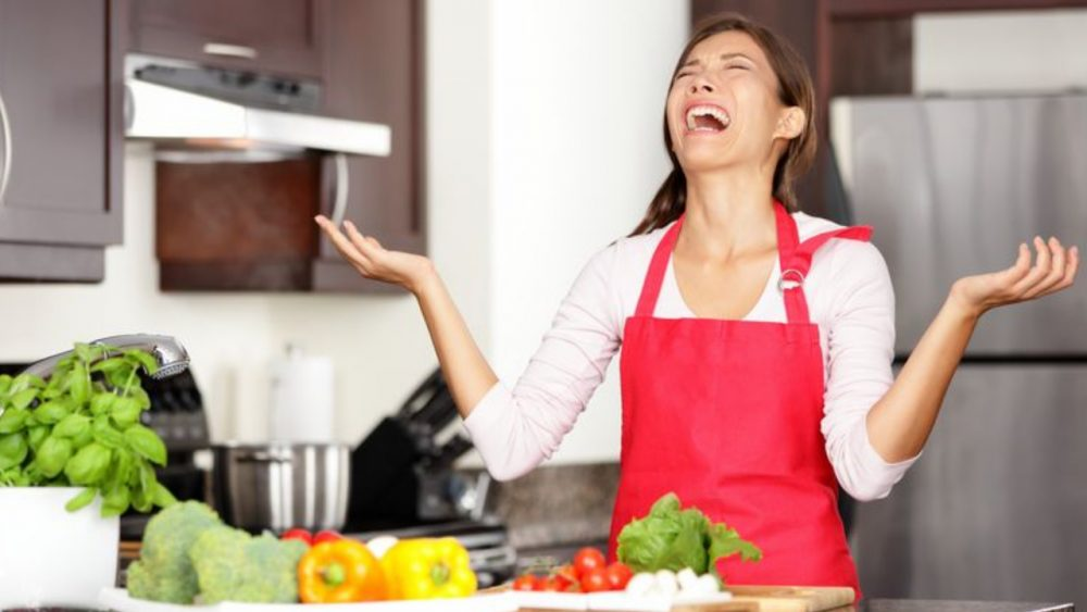 angry womoan yelling in kitchen while cooking