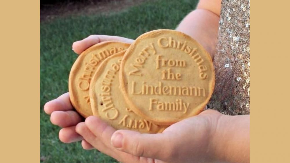kid holding personalized cookies