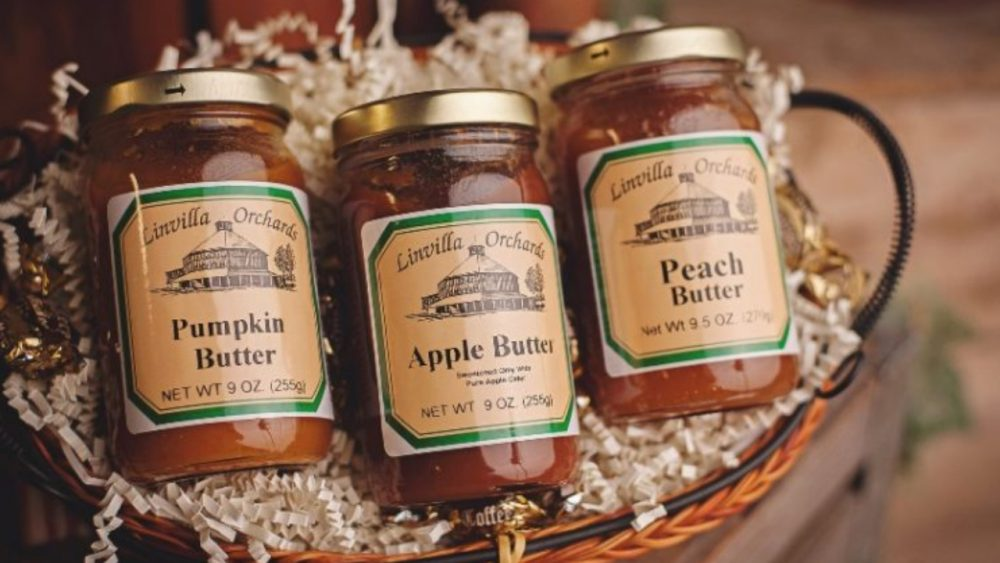 three jars of apple, peach, and pumpkin butter