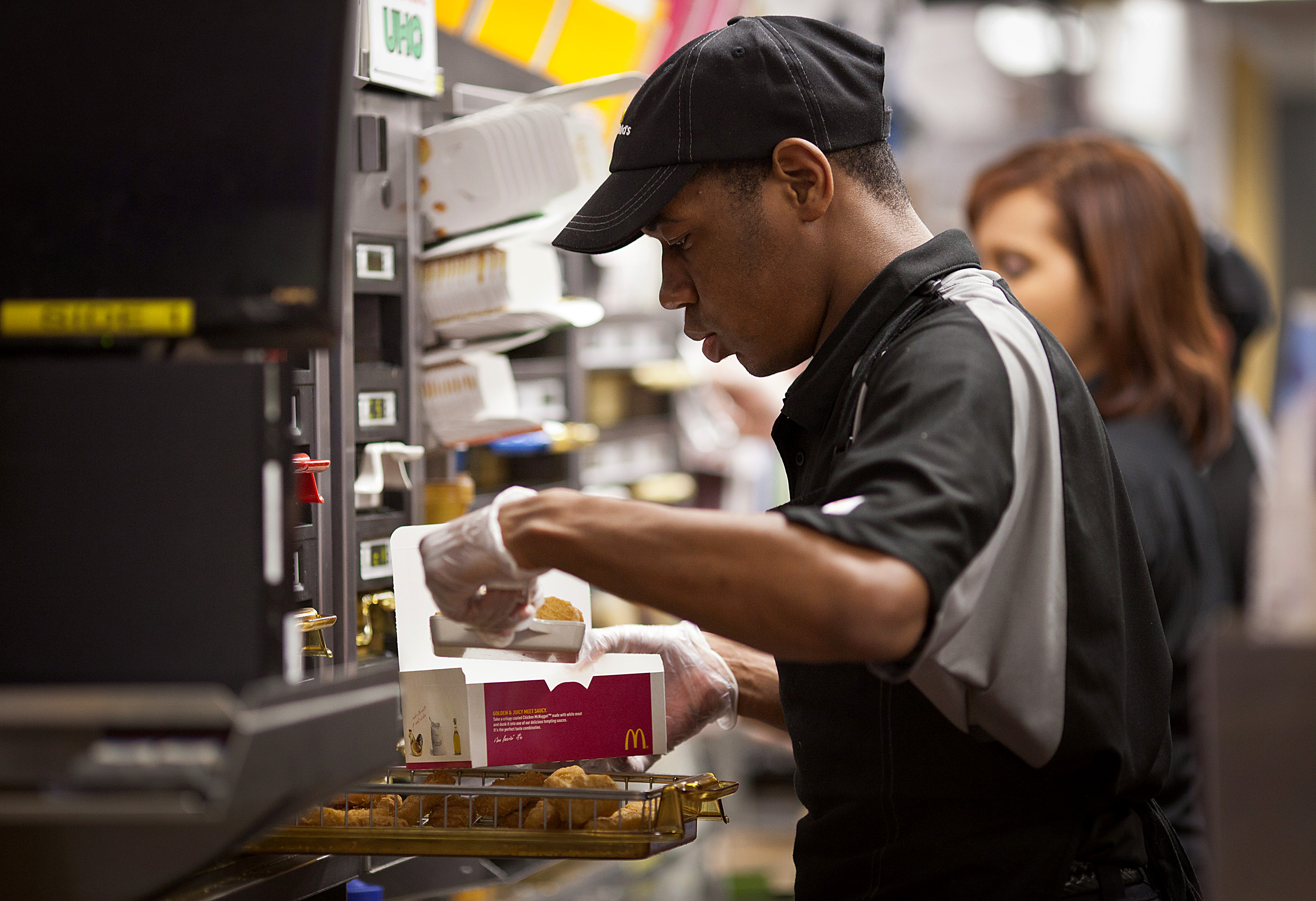 worker making McNuggets
