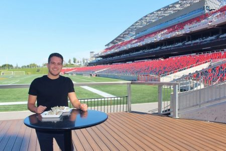 Ottawa's preeminent food blogger Carlo poses with the TD Place Very Vegan Tacos