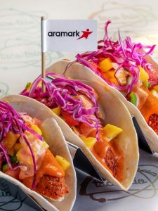 Battle Red Tacos in formation and with the Aramark flag