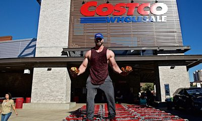 Bodybuilder with Costco rotisserie chicken on both hands