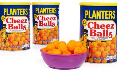 three containers and a bowl of planters cheez puffs