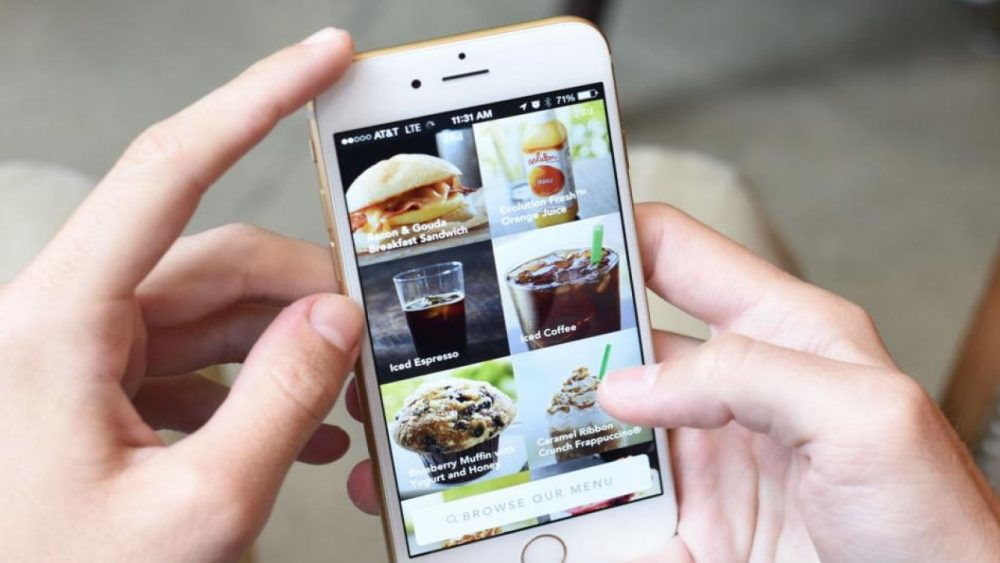 person ordering food and drinks on phone app