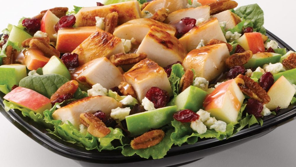 big salad with chicken and toppings