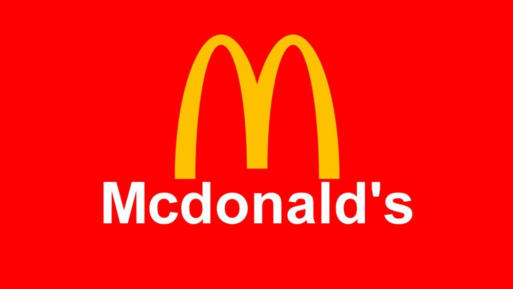 McDonalds golden arches logo red background