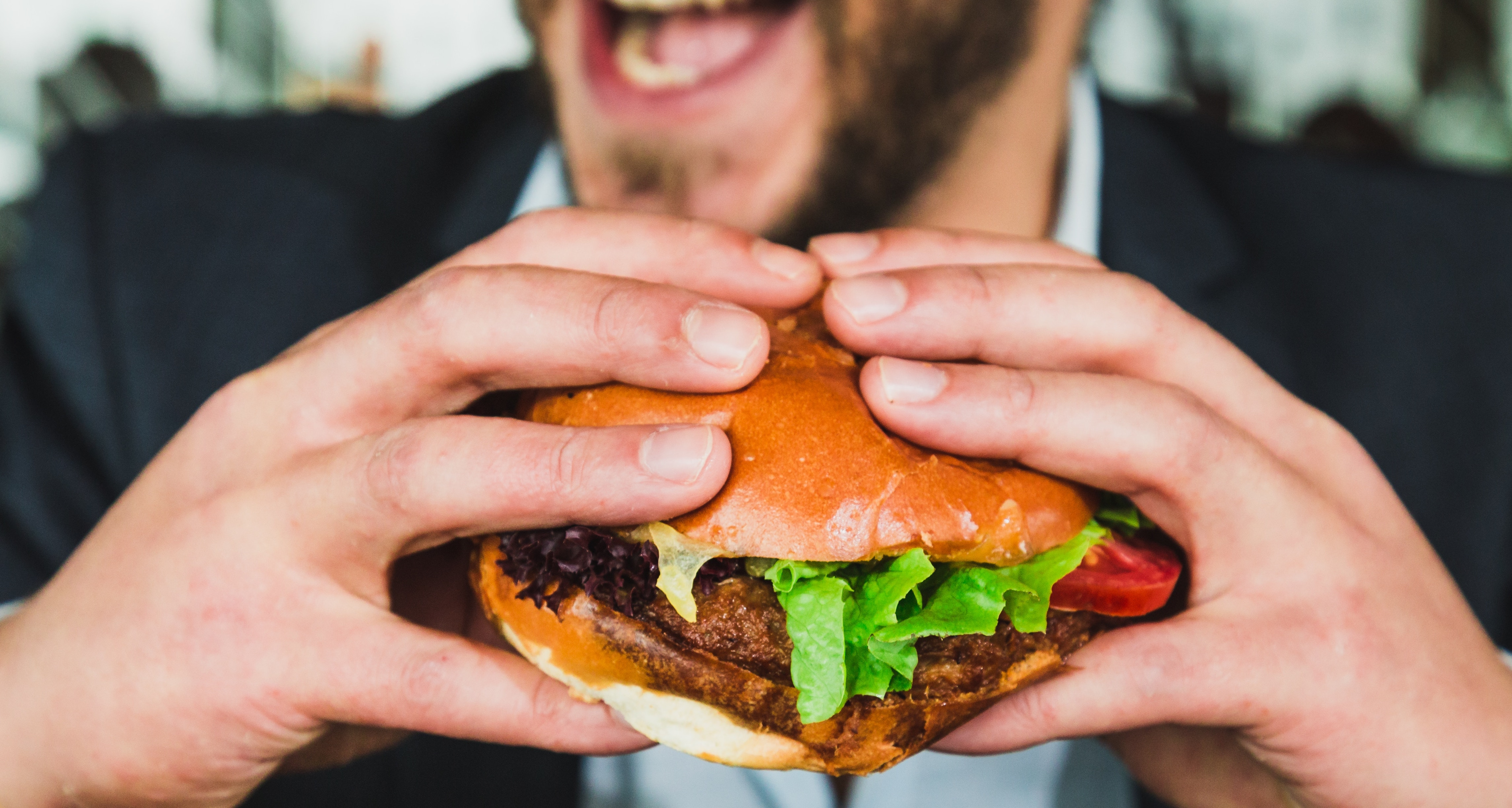 Whopper burger in hand