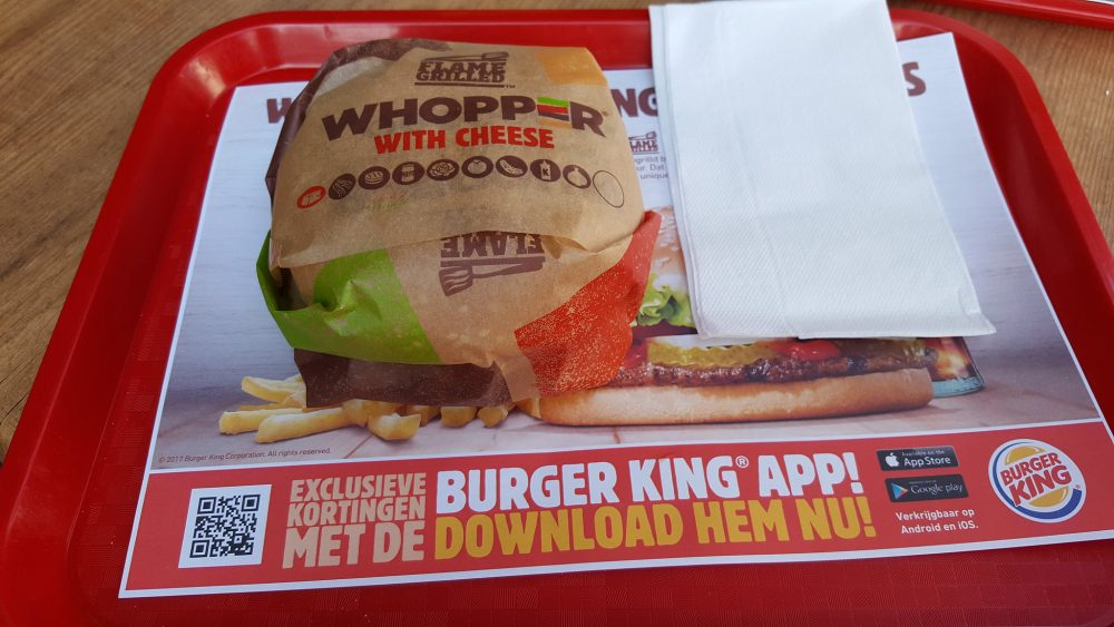 Burger King Whopper in wrapper on tray