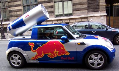 giant Red Bull can on top of a car