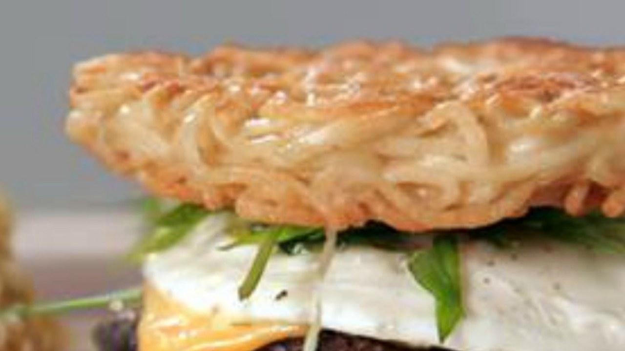 A burger with a noodle bun.