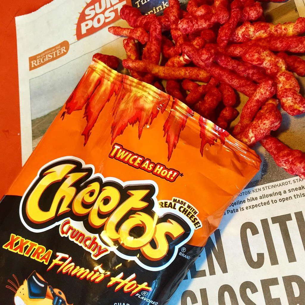 Flamin' Hot Cheetos open pack on newspaper