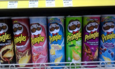 tubes of various Pringles flavors on shelf