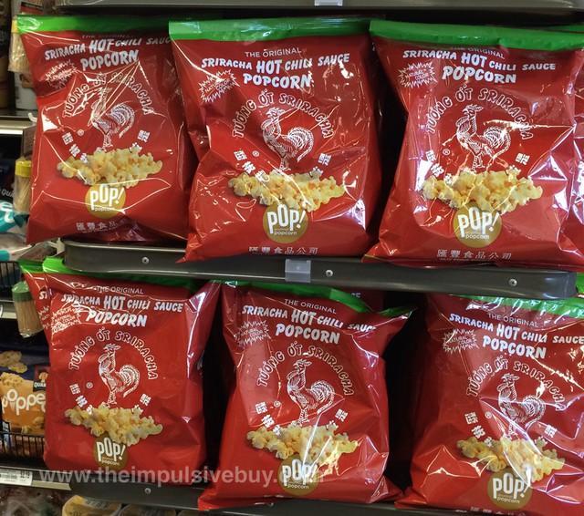bags of sriracha popcorn on supermarket shelf