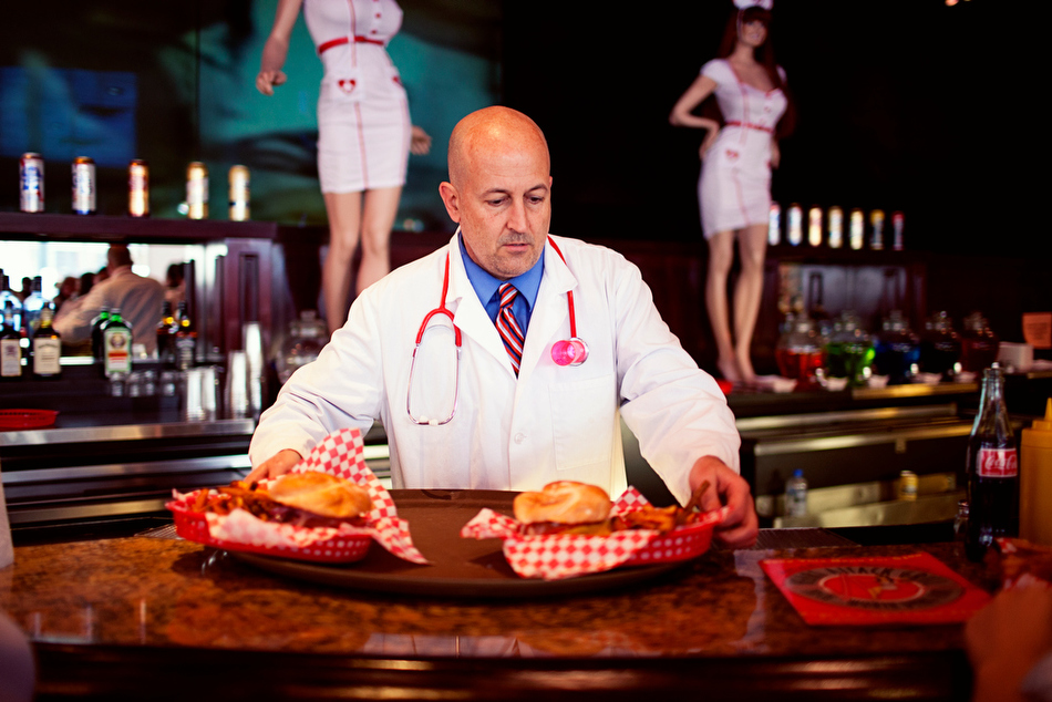 man in doctor's costume serving burgers