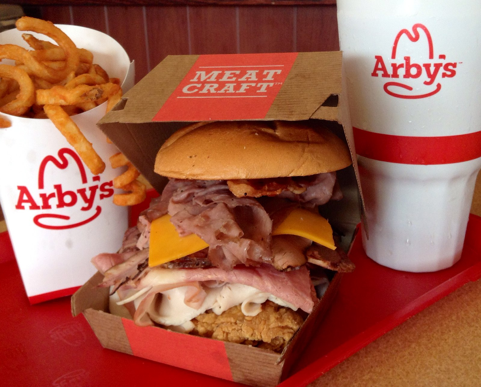 Arby's sandwich, fries and cup of drink