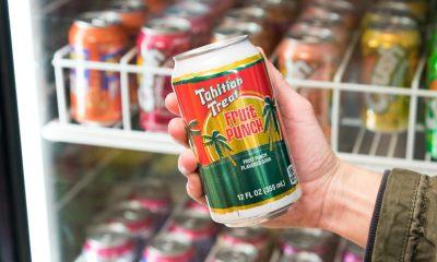Tahitian Treat soda in hand at supermarket