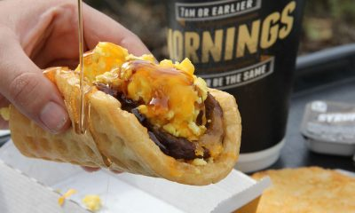 Waffle Taco in hand next to coffee