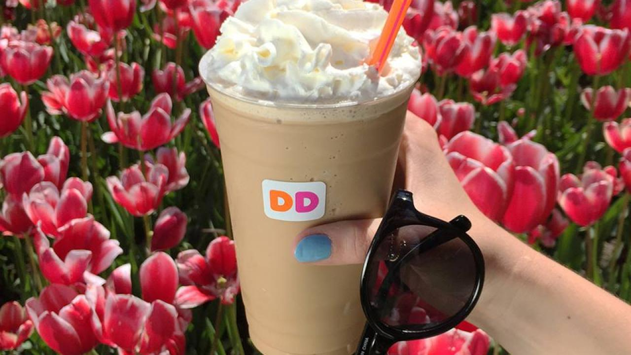 A Dunkin' Donuts drink in the summertime sunshine.