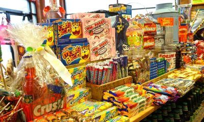 Image shows a shelf full of candy.