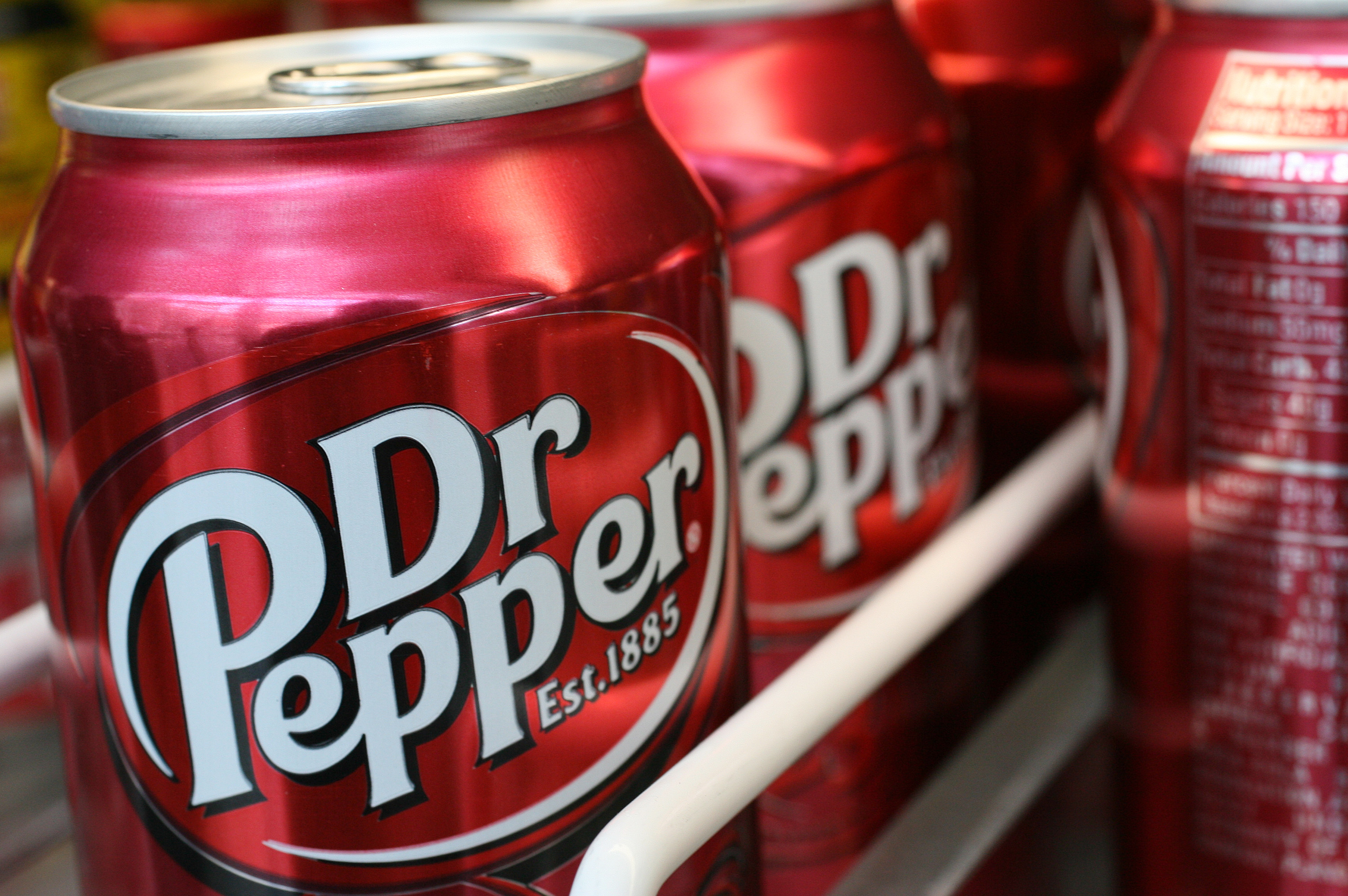 Cans of Dr Pepper sit on a pantry shelf in New York, Tuesday