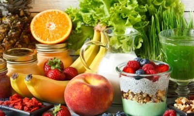 Image shows basic foods on a table. Berries, fruit, and vegetables.