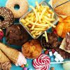 different kinds of junk foods on a blue background