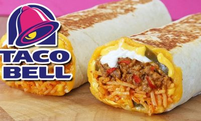 A Taco Bell burrito with the Taco Bell logo.